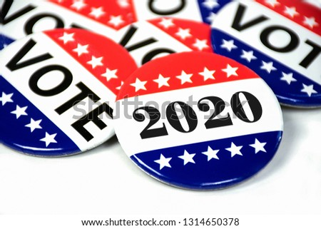 close up of political voting pins for 2020 election on white #1314650378