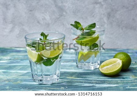 Mojito cocktail on the grey wall #1314716153