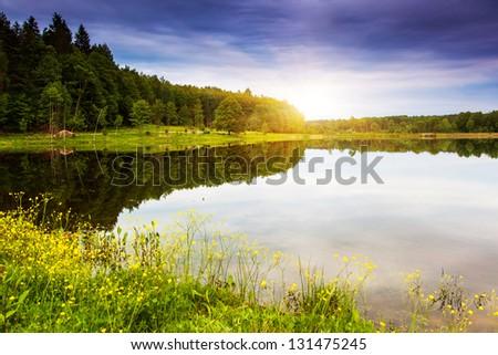 Fantastic landscape with lake and dramatic sky. Overcast sky. Carpathian, Ukraine, Europe. Beauty world. #131475245