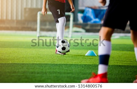 Blurry ball after soccer player shoot it on green artificial turf. for sport background. #1314800576