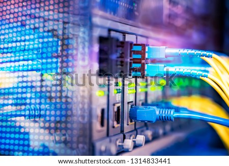 fiber optical cables connected to optic ports and UTP Network cables connected to ethernet ports. #1314833441