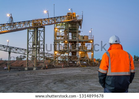 Unidentifiable miner in front of a copper mine head in NSW Australia #1314899678