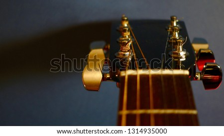 guitar headstock with tuning pegs . color background                              #1314935000