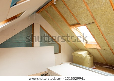House attic insulation and renovation. Drywall construction #1315029941