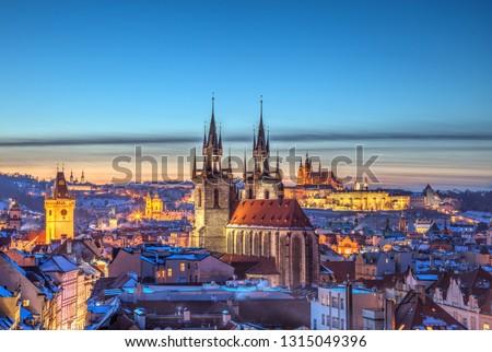 Rooftop view over historical center of Prague, Czech republic, EU. Tyn Church and Prague Castle in beautiful sunset light. #1315049396