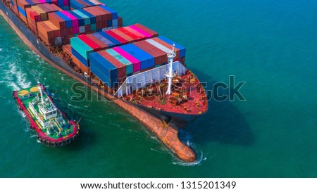 Container ship arriving in port, Tug boat and container ship going to deep sea port, logistic business import export shipping and transportation, Aerial view. #1315201349