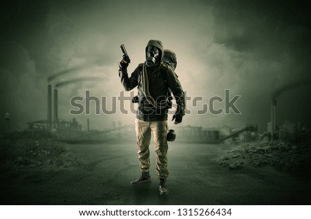 Gas masked survival man coming with arms on his hand  in a demolished dark environment  #1315266434