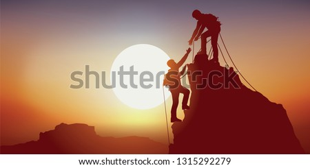 Concept of solidarity, with two mountaineers holding out their hand reaching the top of a mountain, having climbed it successfully
