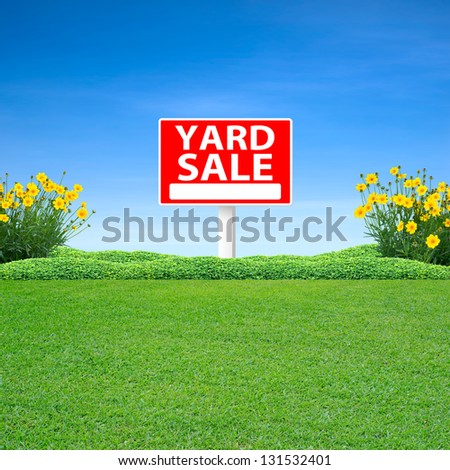Yard sale sign and green grass