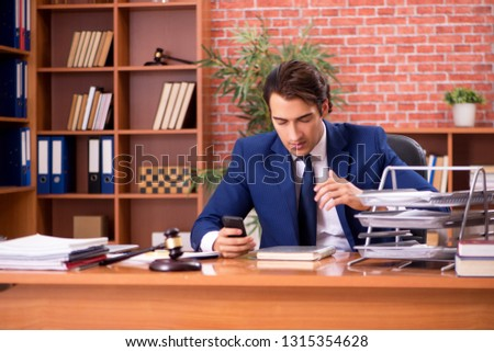 Young handsome lawyer working in his office  #1315354628