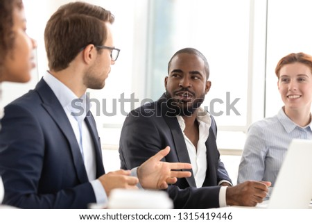 Diverse businessmen businesswomen listening company boss team leader business coach during formal meeting or corporate training seminar. Negotiations between parties, cooperation and mentoring concept #1315419446