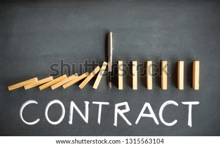Chain Reaction and Contract Concept with Dominoes Toppling on Blackboard #1315563104
