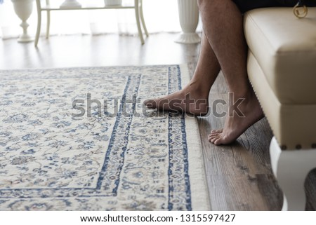 closed up leg step on carpet texture on wooden floor #1315597427