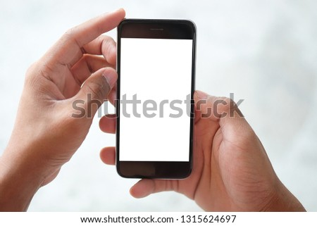 Mock up smartphone of hand holding black mobile phone with blank white screen. #1315624697