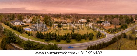 Aerial panorama of American luxury real estate neighborhood in Maryland with single family houses, mansions, high quality buildings with lot of land #1315656182