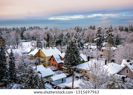 Snowy roof patterns mark urban residential area in Vancouver Canada #1315697963