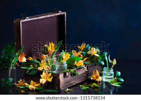 Floral header with yellow flowers in glass jars with green leaves. Home decoration concept with copy space #1315738154