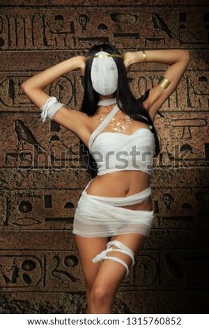 Sexy bandaged mummy woman on egypt hieroglyphs background #1315760852