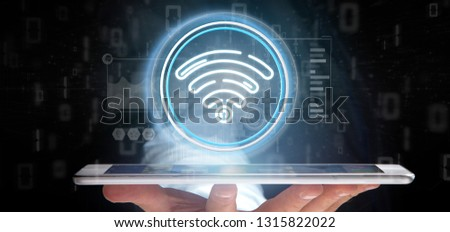 View of Businessman holding Wifi icon with stats and binary code 3d rendering #1315822022