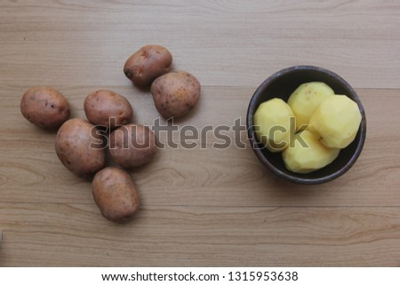 red potato slices are ready to be fried #1315953638
