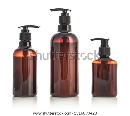 Plastic brown bottles with dispenser pumps isolated on white background.  #1316090423
