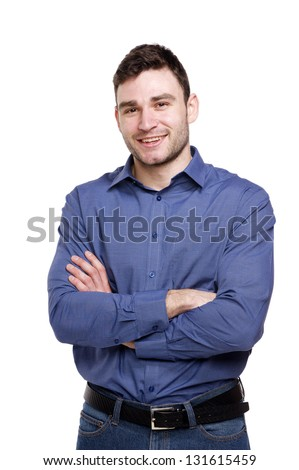 Handsome man wearing a blue shirt and jeans isolated on a white background #131615459
