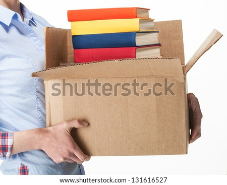 Student holding a big box with stack of books; isolated on white #131616527