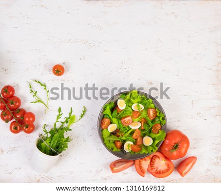 Healthy food on white boards. Food on a white background. Salad in a plate on white boards #1316169812