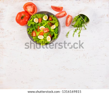 Healthy food on white boards. Food on a white background. Salad in a plate on white boards #1316169815