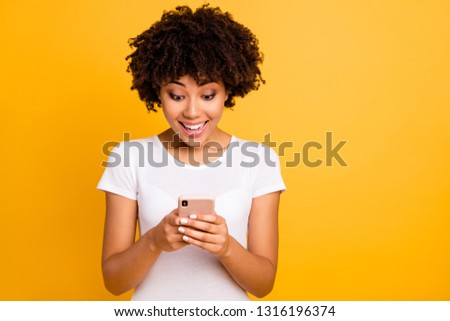 Portrait of her she nice cute attractive lovely charming cheerful focused wavy-haired lady typing sms using new app 5g isolated on bright vivid shine yellow background #1316196374