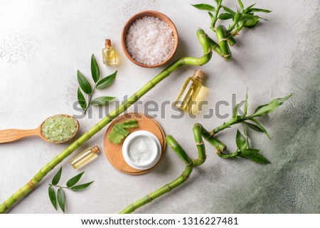 Beautiful spa composition with cosmetics on light background #1316227481