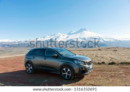 FEBRUARY 12,2019 TURKEY.The SUV Peugeot 3008 with the snowy mountain background. #1316350691