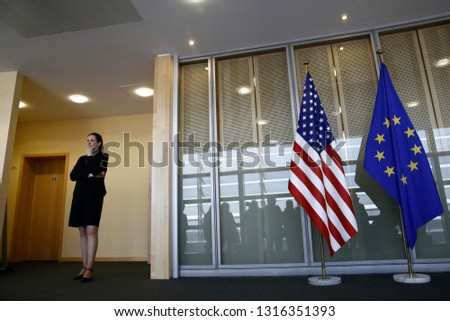 European and US flags in European Commission offices in Brussels, Belgium on Feb. 18, 2019 #1316351393