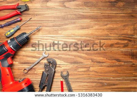 different construction tools on wooden background with copy space. diy construction tools on the brown table #1316383430