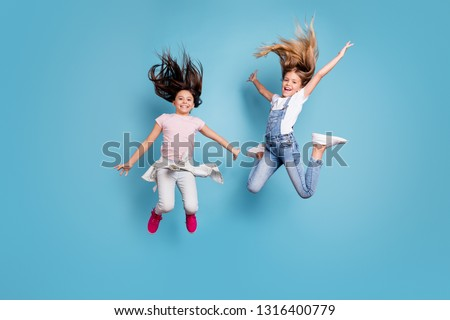 Full length body size view of two people nice crazy attractive cheerful carefree careless straight-haired pre-teen girls having fun great cool day free time overjoy isolated on blue background #1316400779