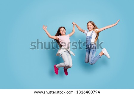 Full length body size view of two people nice cute lovely attractive cheerful cheery careless straight-haired pre-teen girls having fun great day isolated over blue pastel background #1316400794