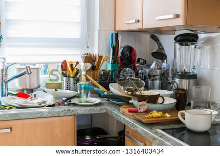 Compulsive Hoarding Syndrom - messy kitchen with pile of dirty dishes Royalty-Free Stock Photo #1316403434