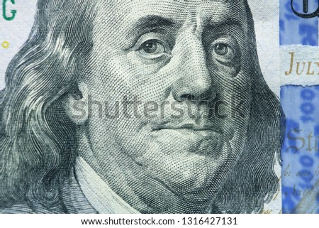 Benjamin Franklin portrait macro US 100 dollar banknote #1316427131