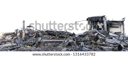 Ruined building. A pile of concrete, rubble and reinforcement debris isolated on a white background. #1316433782
