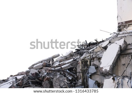 Ruined building. A pile of concrete, rubble and reinforcement debris isolated on a white background. #1316433785