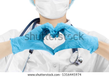 Doctor making a heart sign by his hands, isolated a backgroun #1316445974