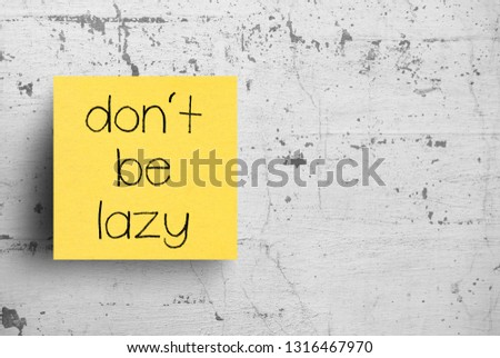 Sticky note on concrete wall, Don't be lazy #1316467970