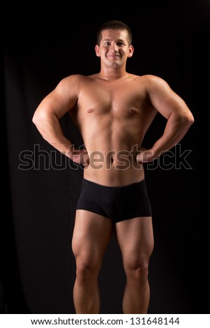 Bodybuilder posing in off season shape #131648144