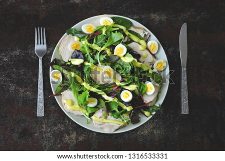 Healthy salad with quail eggs, salad mix and chicken breast. Keto diet. Paleo. Pegan #1316533331