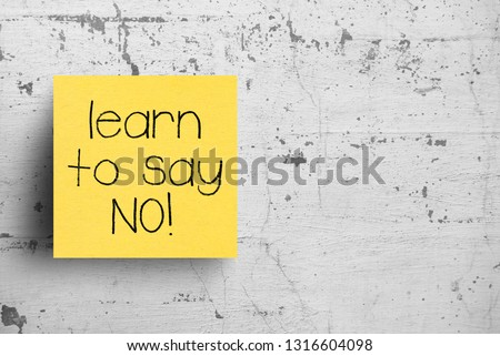 Sticky note on concrete wall, Learn to say No #1316604098