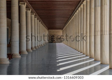 Stoa of Attalos, on Agora of Athens, Greece. Built by King Attalos II of Pergamon, typical of hellenistic age. Stoa of Attalos located under the rock of Acropolis in Athens, Greece #1316609303