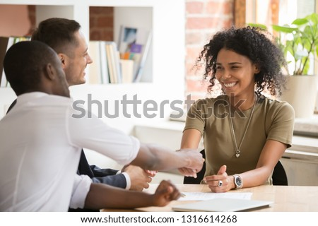 Happy female african vacancy candidate shaking hand of hr recruiting manager congratulating hired applicant with handshake, successful interview winner make good first impression got new job concept Royalty-Free Stock Photo #1316614268