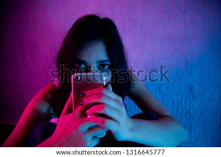 sad and scared female teenager with computer laptop suffering cyberbullying and harassment being online abused by stalker or gossip feeling desperate and humiliated in cyber bullying #1316645777