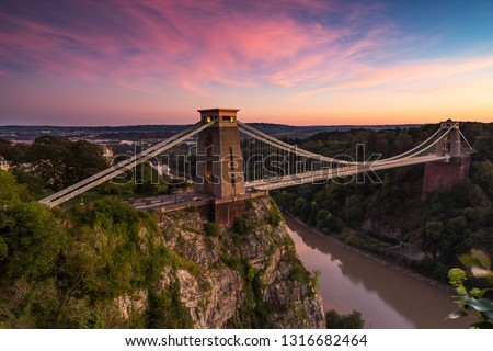 famous Clifton suspension bridge on Bristol at the sunste Royalty-Free Stock Photo #1316682464