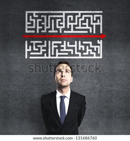 businessman looking at maze with red arrow #131686760